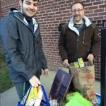 Staff members delivering food items to Hands On Hartford, collected from generous patrons during our holiday food drive.